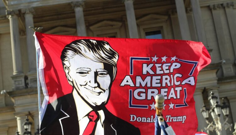 Flag-at-at-a-Trump-Rally-outside-the-Michigan-State-Capitol-Saturday-Nov.-7.-scaled.jpg